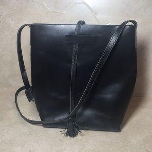 Black Eileen Fisher leather crossbody bag. 106
